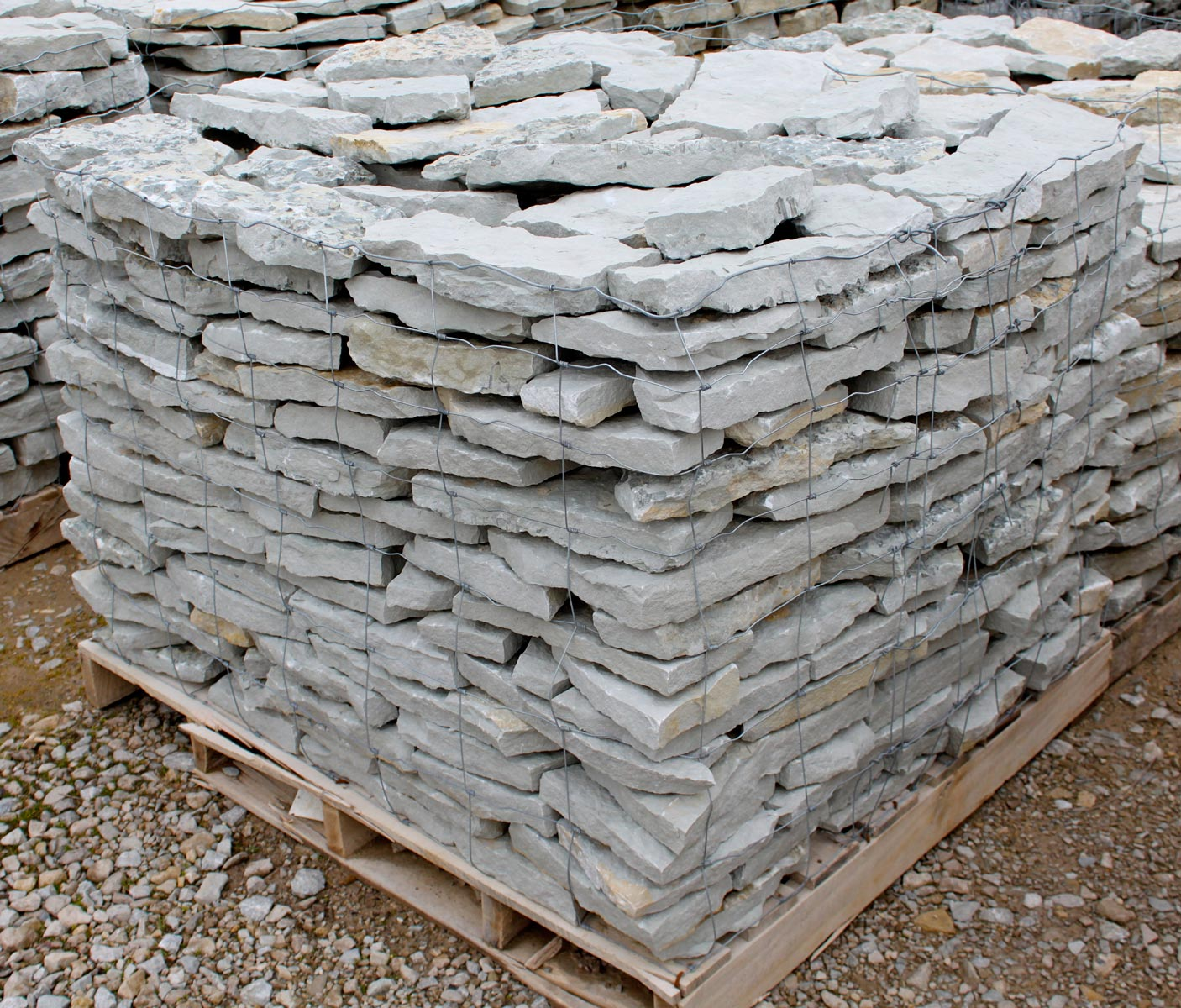 Retaining wall green stone company natural stone and for Smooth stones for landscaping